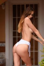 Jennifer Teasing In White Bodysuit 05