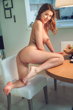 Sybil sits with her legs spread wide 17