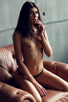 Luiza Strips On An Armchair