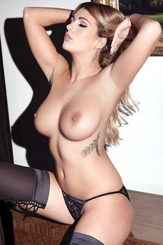 Busty Holly Peers Posing Topless