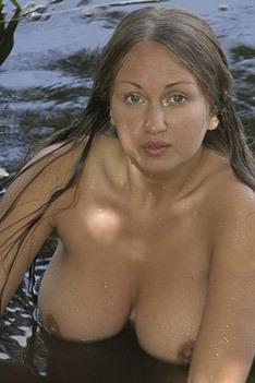 Aneli Posing Naked On The Riverbank