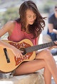 Janice Griffith Playing On Her Guitar